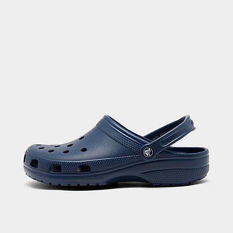 Crocs Classic Clog Shoes in Blue/Navy Size 13.0 Shop All Crocs Jibbitz™ charms to personalize your Crocs! Sizing Information UNISEX SIZING: Unisex shoes are equal to men's shoe sizing Women, select 2 sizes smaller than your typical shoe size Ex. If you wear a women's size 10, you would select an 8 in this clog Men and Big Kids, select your typical shoe size Product Features Super lightweight and roomy Croslite foam cushioning for all day comfort Water-friendly and buoyant Ports at the toebox for ventilated breathability Movable heel strap locks you in Wipe clean The Crocs Classic Clog is imported. Generously roomy and ultra-comfortable, the Crocs Classic Clog Shoes offer up plenty of versatile style and lightweight flexibility. Size: 13.0. Color: Blue. Gender: male. Age Group: adult. Crocs Classic Clog Shoes in Blue/Navy Size 13.0