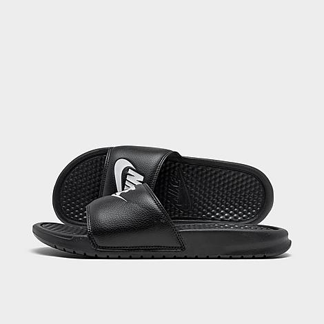 Nike Men's Benassi JDI Slide Sandals in Black/Black Size 10.0 Leather Sizing runs a bit narrow, consider ordering a half-size up. Few sayings sum up the competitive spirit much like the three words that have become the mantra for sports enthusiasts everywhere. The Men's Nike Benassi Just Do It Slide Sandal continues this lasting legacy with plenty of style and the perfect fit. The textured footbed and Phylon midsole/outsole offer superior comfort before and after training or competition. Iconic details deliver a bold look and let everyone know that you came to play. FEATURES: UPPER: One-piece, synthetic leather MIDSOLE: Phylon cushioning OUTSOLE: Rubber with herringbone traction pattern IMPORTED Size: 10.0. Color: Black. Gender: male. Age Group: adult. Nike Men's Benassi JDI Slide Sandals in Black/Black Size 10.0 Leather