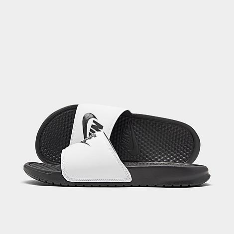 Nike Men's Benassi JDI Slide Sandals in White/Black/White Size 11.0 Leather Sizing runs a bit narrow, consider ordering a half-size up. Few sayings sum up the competitive spirit much like the three words that have become the mantra for sports enthusiasts everywhere. The Men's Nike Benassi Just Do It Slide Sandal continues this lasting legacy with plenty of style and the perfect fit. The textured footbed and Phylon midsole/outsole offer superior comfort before and after training or competition. Iconic details deliver a bold look and let everyone know that you came to play. FEATURES: UPPER: One-piece, synthetic leather MIDSOLE: Phylon cushioning OUTSOLE: Rubber with herringbone traction pattern IMPORTED Size: 11.0. Color: White/Black. Gender: male. Age Group: adult. Nike Men's Benassi JDI Slide Sandals in White/Black/White Size 11.0 Leather