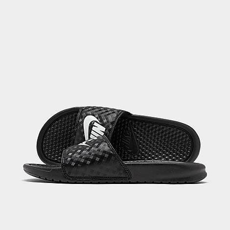 Nike Women's Benassi JDI Swoosh Slide Sandals in Black/Black Size 6.0 Treat your feet in these comfy sandals One piece synthetic upper Slip on design Phylon foam midsole/outsole Herringbone traction pattern on the sole The Nike Benassi JDI Swoosh is imported. Few sayings sum up the competitive spirit much like the three words that have become the mantra for sports enthusiasts everywhere. The Women's Nike Benassi Just Do It Slide Sandal continues this lasting legacy with plenty of style and a just-right fit. Size: 6.0. Color: Black. Gender: female. Age Group: adult. Nike Women's Benassi JDI Swoosh Slide Sandals in Black/Black Size 6.0