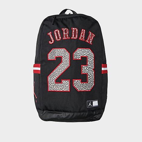 Jordan Jersey Backpack in Black/Black Leather/100% Polyester/Jersey Densely woven material holds shape Secured with zip closures Synthetic snake-infill embroidered branding Spacious main compartment with organizational slots Jock tag logo and Jumpman silhouette details Plush lined pocket offers secure storage for delicate belongings such as glasses, phones Side slip pockets with striped trim Mirrored chevron-stitched quilted back mesh paneling Top haul loop offers versatile carrying, storing options Adjustable, contoured lightly padded shoulder straps for a comfortable, stabilized wearing experience Protective tarpaulin base 10.5  L x 6  W x 19  H Body: 100% polyester, Logo: 100% leather and Logo: 100% polyurethane Spot clean The Jordan Jersey Backpack is imported. Consider this the G.O.A. T of all bags! Ranking high in the looks and specs department, the Jordan Jersey Backpack plays it cool in details and bold in functionality. Centered around Michael Jordan's #23 jersey, bold contrast embroidery is filled with a synthetic snakeskin backdrop for a slithering spin on a classic design. Finished with mesh paneling at the back and adjustable, contoured shoulder straps, it offers a comfortable, stabilized wearing experience. Color: Black. Gender: unisex. Age Group: adult. Pattern: Chevron/Embroidered/Striped. Material: Leather/100% Polyester/Jersey. Jordan Jersey Backpack in Black/Black Leather/100% Polyester/Jersey