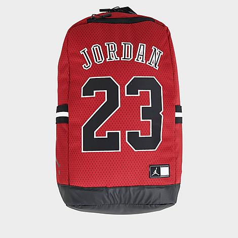 Jordan Jersey Mesh Backpack in Red/Red Leather/100% Polyester/Jersey Densely woven material with mesh overlay holds shape Secured with zip closures Jersey-inspired graphics Spacious main compartment with organizational slots Jock tag logo and Jumpman silhouette details Plush lined pocket offers secure storage for delicate belongings such as glasses, phones Side slip pockets with striped trim Mirrored chevron-stitched quilted back mesh paneling Top haul loop offers versatile carrying, storing options Adjustable, contoured lightly padded shoulder straps for a comfortable, stabilized wearing experience Protective tarpaulin base 10.5  L x 6  W x 19  H Body: 100% polyester, Logo: 100% leather and Logo: 100% polyurethane Spot clean The Jordan Jersey Mesh Backpack is imported. Carry gear inspired by his  airness  himself with the Jordan Jersey Mesh Backpack. Taking cues from the legendary ballplayer's #23 jersey, it boasts a mesh-overlayed woven construction, spacious interior, various organizational compartments and super-fan graphics. Gender: unisex. Age Group: adult. Pattern: Chevron/Striped/Spot. Material: Leather/100% Polyester/Jersey. Jordan Jersey Mesh Backpack in Red/Red Leather/100% Polyester/Jersey