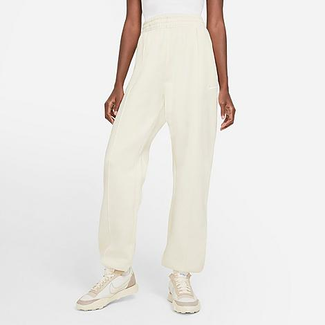 Nike Women's Sportswear Essential Fleece Jogger Pants in Off-White/Coconut Milk Size X-Small Cotton/Polyester/Fleece Size & Fit Relaxed, loose fit has a drapey look and cozy feel Elastic waistband for an adjustable fit Product Features Brushed-back fleece is soft and warm Pin tucks down the front legs Embroidered Swoosh design at left leg Elastic jogger-style cuffs show off your sneakers Front pockets for small item storage or to warm hands 80% cotton, 20% polyester Machine wash The Nike Sportswear Essential Fleece Jogger Pants are imported. Lounge in style in the Women's Nike Sportswear Essential Fleece Jogger Pants. Made with cozy, brushed-back fleece in a loose fit, these pants give you a stylish look and total comfort for staying in or heading out. Size: X-Small. Color: Off-White. Gender: female. Age Group: adult. Material: Cotton/Polyester/Fleece. Nike Women's Sportswear Essential Fleece Jogger Pants in Off-White/Coconut Milk Size X-Small Cotton/Polyester/Fleece