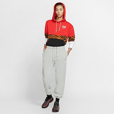 Nike Women's Sportswear Essential Lightweight Fleece Jogger Pants in Grey/Dark Grey Heather Size Small Cotton/Polyester/Fleece Size & Fit Relaxed, loose fit has a drapey look and cozy feel Elastic waistband for an adjustable fit Product Features Semi-brushed fleece for lightweight warmth Nike branding for style Elastic jogger-style cuffs show off your sneakers Front pockets for small item storage or to warm hands 80% cotton, 20% polyester Machine wash The Nike Sportswear Essential Lightweight Fleece Jogger Pants are imported. Cozy without bulk, the Women's Nike Sportswear Essential Lightweight Fleece Jogger Pant is a wardrobe staple. Made with semi-brushed fleece in a loose fit, these pants give you a stylish look and total comfort for staying in or heading out. Color: Grey. Gender: female. Age Group: adult. Material: Cotton/Polyester/Fleece. Nike Women's Sportswear Essential Lightweight Fleece Jogger Pants in Grey/Dark Grey Heather Size Small Cotton/Polyester/Fleece