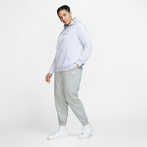 Nike Women's Sportswear Essential Jogger Pants (Plus Size) in Grey/Grey Heather Size 2X-Large Cotton/Polyester/Fleece Soft and warm brushed back fleece Side pockets for convenient storage Elastic waistband with drawcord 80% cotton, 20% polyester blend material Slightly relaxed fit Machine wash The Nike Sportswear Jogger Pants (Plus Size) are imported. Cozy comfort and low-key style make the Women's Nike Sportswear Essential Jogger Pants (Plus Size) an everyday essential. Boasting jogger-style cuffs and ultra-soft fabric, these pants take you from sweat sessions to coffee dates with ease. Size: 2X-Large. Color: Grey. Gender: female. Age Group: adult. Material: Cotton/Polyester/Fleece. Nike Women's Sportswear Essential Jogger Pants (Plus Size) in Grey/Grey Heather Size 2X-Large Cotton/Polyester/Fleece
