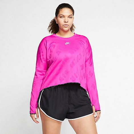 Nike Women's Air Midlayer Crew Training Top (Plus Size) in Pink/Fire Pink Size 2X-Large Polyester/Spandex/Jacquard Size & Fit Standard fit has a relaxed feel Cropped hem is flattering and trend-right Elastic at hem and cuffs seal in the fit Product Features Poly and spandex blend fabric is boosted with Dri-FIT technology to wick away moisture Jacquard Nike Air allover print has a slight sheen Thumbholes at cuffs add extra coverage Dropped shoulder seams enhance mobility Reflective accents get you noticed 94% polyester, 6% spandex Machine wash The Nike Air Midlayer Crew Training Top is imported. Dress for warmth without bulk for your next training session in the Women's Nike Air Midlayer Crew Training Top (Plus Size). A cropped hem and cozy material combine with sweat-wicking technology to keep you comfortable and dry as you rack up the miles. Size: 2X-Large. Color: Pink. Gender: female. Age Group: adult. Material: Polyester/Spandex/Jacquard. Nike Women's Air Midlayer Crew Training Top (Plus Size) in Pink/Fire Pink Size 2X-Large Polyester/Spandex/Jacquard