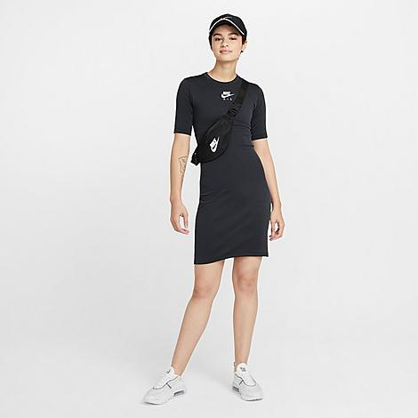 Nike Women's Sportswear Air Dress in Black/Black Size Small Nylon/Polyester/Spandex Size & Fit Tight fit flatters your figure Product Features Soft and stretchy fabric is breathable and light Embroidered graphics at the chest 45% polyester, 53% nylon, 2% spandex Machine wash The Nike Sportswear Air Dress is imported. When you're running late and need an easy outfit that's still fresh and fun, the Women's Nike Sportswear Air Dress fits the bill. A 2-color rib design and embroidered graphics deliver an elevated take on the daily body con tee dress. Size: Small. Color: Black. Gender: female. Age Group: adult. Pattern: Embroidered/Graphic. Material: Nylon/Polyester/Spandex. Nike Women's Sportswear Air Dress in Black/Black Size Small Nylon/Polyester/Spandex