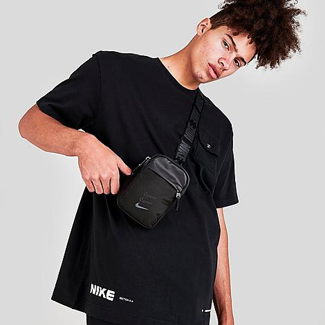 Nike Men's Sportswear City Made Casual T-Shirt in Black/Black Size Large Cotton/Jersey Size & Fit Standard fit for a relaxed, easy feel Product Features Durable, heavy-duty cotton Snap-secured pocket for small essentials Mesh panel keeps you cool with premium ventilation Machine wash The Nike Sportswear City Made Casual T-Shirt is imported. Simplicity meets sophistication with the Men's Nike Sportswear City Made Casual T-Shirt. Made with heavyweight cotton jersey material and featuring a meticulously engineered mesh panel for maximum breathability and snap-pocket for small essentials, this minimalistic design makes for a great addition to any wardrobe. Size: Large. Color: Black. Gender: male. Age Group: adult. Material: Cotton/Jersey. Nike Men's Sportswear City Made Casual T-Shirt in Black/Black Size Large Cotton/Jersey