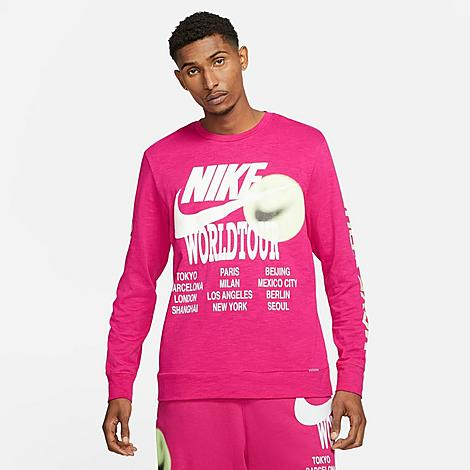 Nike Men's Sportswear World Tour Long-Sleeve T-Shirt in Pink/Fireberry Size X-Small 100% Cotton Size & Fit Standard fit is athletic and relaxed Long sleeves for enhanced coverage Product Features Heavyweight cotton is sturdy and comfortable Ribbed neckband and cuffs Bold graphics throughout 100% cotton Machine wash The Nike Sportswear World Tour Long-Sleeve T-Shirt is imported. Stand out from the crowd while maintaining your comfort with the Men's Nike Sportswear World Tour Long-Sleeve T-Shirt. Sturdy cotton and bold graphics team up on this must-have staple. Size: X-Small. Color: Pink. Gender: male. Age Group: adult. Nike Men's Sportswear World Tour Long-Sleeve T-Shirt in Pink/Fireberry Size X-Small 100% Cotton