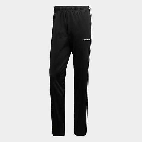 Adidas Men's Essentials 3-Stripes Tapered Pants in Black/Black Size Small Polyester Size & Fit Regular fit is roomy and easygoing, yet tapered and streamlined at the ankle Elastic waistband with adjustable drawcord Made from Sustainable Materials This product is made from 100% recycled polyester tricot, so you can feel good about saving resources when you wear these pants Product Features Smooth, soft fabric is breathable and comfortable Open hems Side slash hand pockets for small item storage 3-Stripes branding at the sides Machine wash The adidas Essentials 3-Stripes Tapered Pants are imported. Versatile and ultra-comfy, the Men's adidas Essentials 3-Stripes Tapered Pants carry you from workouts to coffee trips with ease. Color: Black. Gender: male. Age Group: adult. Pattern: Striped. Adidas Men's Essentials 3-Stripes Tapered Pants in Black/Black Size Small Polyester