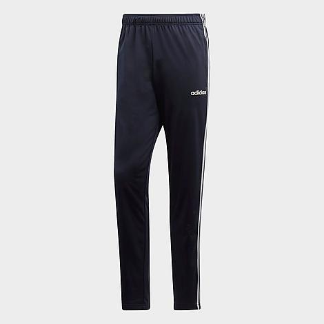 Adidas Men's Essentials 3-Stripes Tapered Pants in Blue/Dark Blue Size Small Polyester Size & Fit Regular fit is roomy and easygoing, yet tapered and streamlined at the ankle Elastic waistband with adjustable drawcord Made from Sustainable Materials This product is made from 100% recycled polyester tricot, so you can feel good about saving resources when you wear these pants Product Features Smooth, soft fabric is breathable and comfortable Open hems Side slash hand pockets for small item storage 3-Stripes branding at the sides Machine wash The adidas Essentials 3-Stripes Tapered Pants are imported. Versatile and ultra-comfy, the Men's adidas Essentials 3-Stripes Tapered Pants carry you from workouts to coffee trips with ease. Color: Blue. Gender: male. Age Group: adult. Pattern: Striped. Adidas Men's Essentials 3-Stripes Tapered Pants in Blue/Dark Blue Size Small Polyester