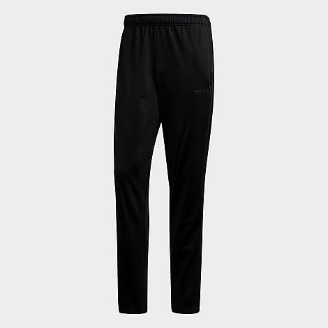 Adidas Men's Essentials 3-Stripes Tapered Pants in Black/Black Size Large Polyester Size & Fit Regular fit is roomy and easygoing, yet tapered and streamlined at the ankle Elastic waistband with adjustable drawcord Made from Sustainable Materials This product is made from 100% recycled polyester tricot, so you can feel good about saving resources when you wear these pants Product Features Smooth, soft fabric is breathable and comfortable Open hems Side slash hand pockets for small item storage 3-Stripes branding at the sides Machine wash The adidas Essentials 3-Stripes Tapered Pants are imported. Versatile and ultra-comfy, the Men's adidas Essentials 3-Stripes Tapered Pants carry you from workouts to coffee trips with ease. Size: Large. Color: Black. Gender: male. Age Group: adult. Pattern: Striped. Adidas Men's Essentials 3-Stripes Tapered Pants in Black/Black Size Large Polyester