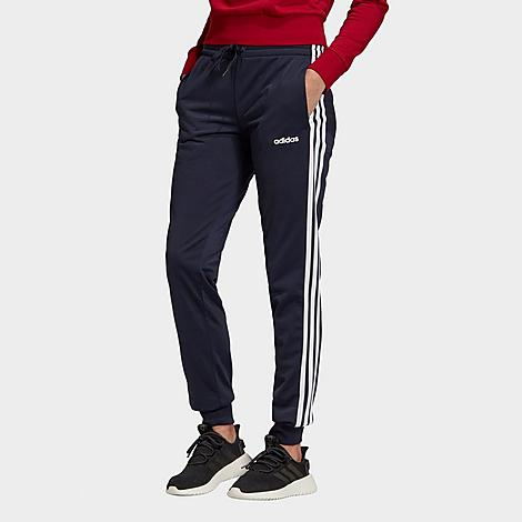 Adidas Women's Training Essentials Jogger Pants in Blue/Legend Ink Size Small Size & FitSlim fit with on-trend, tapered legs for mobility and zero distractions Drawcord at waistband seals in the fit Product FeaturesSporty poly tricot material is smooth and durable 3-Stripes branding at sides Cuffed jogger-style hems Machine wash The adidas Training Essentials Jogger Pants are imported. A classic pant that's anything but boring, the Women's adidas Training Essentials Jogger Pants takes heritage adidas style and adds contemporary construction and materials to the mix. The result? A pair of joggers that offer a comfy feel and stylish look for everything from coffee dates to gym warm ups. Size: Small. Color: Blue. Gender: female. Age Group: adult. Pattern: Striped. Adidas Women's Training Essentials Jogger Pants in Blue/Legend Ink Size Small