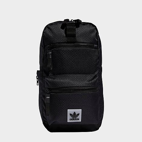 Adidas Originals Utility Sling Crossbody Bag in Black/Black 100% Polyester Densely woven material to combat daily wear and tear Release-buckle straps for an adjustable fit Signature rubberized Trefoil logo tag Front zip pocket for easy access storage Main zip compartment with inner pocket for ample storing Removable key fob Back mesh panel for breathability Side mesh water bottle pocket Sling strap for easy carrying 100% polyester Spot clean The adidas Originals Utility Sling Crossbody Bag is imported. Ensure your essentials are safe and close at hand with the adidas Originals Utility Sling Crossbody Bag. Durable materials and ample storage options make this bag a daily staple. Size: One size. Color: Black. Gender: unisex. Age Group: adult. Adidas Originals Utility Sling Crossbody Bag in Black/Black 100% Polyester