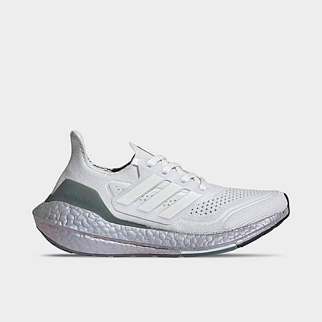 Adidas Girls' Big Kids' UltraBOOST 21 Running Shoes in White/Crystal White Size 4.0 Made From Sustainable MaterialsBuilt from Primeblue - a hyper-performance mix of recycled materials - these sustainably-built sneakers drive to perform with good-for-the-environment looks. Great for the active kiddo committed to personal and environmental health, rock these for training, morning jogs and low/high impact activities, while helping to eliminate waste. Product FeaturesLightweight, breathable textile upper with supportive overlays Mobility-friendly low profile with padded tongue and collar Protective bumper toe Lace closure provides a locked-in fit Signature 3-Stripes and Badge of Sport branding Responsive Torsion System and BOOST midsole for plush, springy comfort High-traction grippy rubber sole The adidas UltraBOOST 21 Running Shoes are imported. A major upgrade to your other runners, the Girls' Big Kids' adidas UltraBOOST 21 Running Shoes implements more performative specs to keep your energetic kiddo driven with high-impact comfort. Through the combination of their iconic BOOST midsole and Torsion System, they provide a responsive, plush feel to overworked feet. Funneling it through a stylish filter, they're amplified with trend-forward details to keep your young runner draped in athletic style. Size: 4.0. Color: White. Gender: female. Pattern: Striped. Adidas Girls' Big Kids' UltraBOOST 21 Running Shoes in White/Crystal White Size 4.0