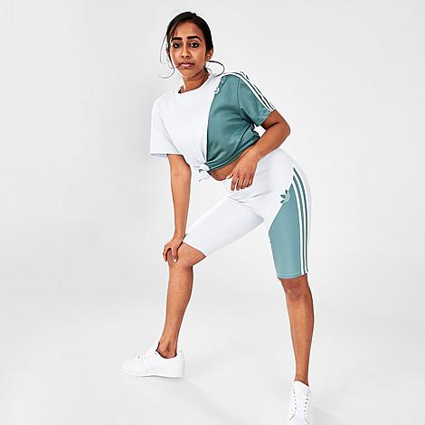 Adidas Women's Originals Adicolor Sliced Trefoil Short Tights in Blue/Halo Blue Size Small Polyester Size & Fit Slim, figure-hugging fit High elastic waist Product Features Sleek and stretchy fabric blend for support and comfort Sliced Trefoil detail for style 91% polyester, 9% elastane interlock Machine wash The adidas Originals Adicolor Sliced Trefoil Short Tights are imported. Stylish and sleek, the Women's adidas Originals Adicolor Sliced Trefoil Short Tights are your new go-to body for everything from walking your fave pooch to coffee with the girls! Size: Small. Color: Blue. Gender: female. Age Group: adult. Adidas Women's Originals Adicolor Sliced Trefoil Short Tights in Blue/Halo Blue Size Small Polyester