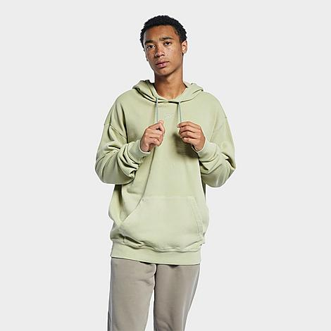 Reebok Men's Classics Natural Dye Hoodie in Green/Harmony Green Size Medium Cotton Size & FitLoose fit is oversized and roomy Product FeaturesCotton French terry is cozy and warm Pullover construction with adjustable hood Ribbed cuffs and hem Kangaroo pocket at the front 100% organic cotton French terry Machine wash The Reebok Classics Natural Dye Hoodie is imported. Natural pigments and an oversized fit team up to bring you the Men's Reebok Classics Natural Dye Hoodie. Cozy, comfortable and eye-catching, this hoodie is a great addition to any streetwear wardrobe. Size: Medium. Color: Green. Gender: male. Age Group: adult. Reebok Men's Classics Natural Dye Hoodie in Green/Harmony Green Size Medium Cotton