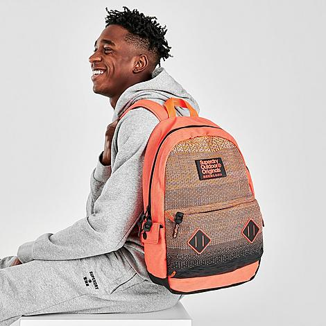 Polyester material Textured Superdry branding throughout Top haul loop Main zip compartment Padded back and adjustable straps for added comfort Exterior and interior pockets Height: 18in x Length: 12in x Depth: 5in Spot Clean The Superdry Knitter Montana Backpack is imported. Stay ahead of the game sporting the Superdry Knitter Montana Backpack. Inspired by the classic Montana rucksack, this bag delivers comfort, plenty of storage and style - seamlessly taking you from class to gym and anywhere in-between. Color: Orange. Gender: male. Age Group: adult. Material: Polyester/Knit. Superdry Men\\\'s Knitter Montana Backpack in Orange/Orange Polyester/Knit