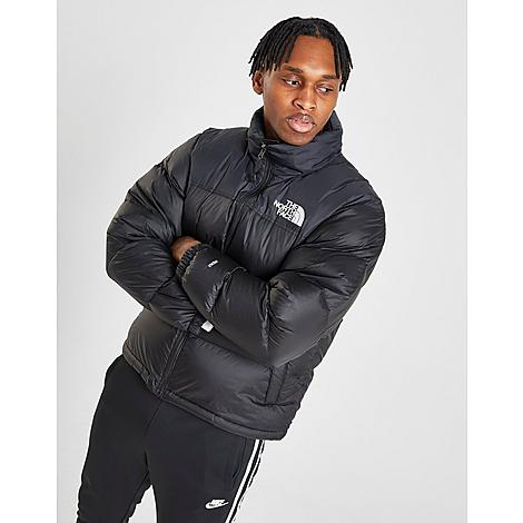 The North Face Inc Men's 1996 Retro Nuptse Jacket in Black/TNF Black Size 2X-Large Nylon 700-fill goose down insulation for insulated warmth Ripstop nylon exterior Removable hood can be packed into collar Interior hand pockets ThermoBall™ ECO powered by Primaloft® Design lines and silhouette inspired by the 1996 Nuptse jacket Boxy fit is perfect over winter sweaters The North Face 1996 Retro Nuptse Jacket is imported. Zip up in the Men's The North Face 1996 Retro Nuptse Jacket for chilly weather days. Featuring goose down and a streamlined puffer silhouette, this jacket keeps you cozy without sacrificing on style. Size: 2X-Large. Color: Black. Gender: male. Age Group: adult. The North Face Inc Men's 1996 Retro Nuptse Jacket in Black/TNF Black Size 2X-Large Nylon