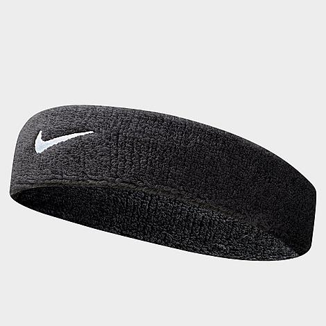 Stretchy, comfortable fabric is highly absorbent Embroidered Swoosh logo for classic Nike styling 72% cotton, 12% nylon, 11% polyester, 4% rubber, 1% spandex The Nike Swoosh Headband is imported. Don\\\'t let sweat interfere with your game. Instead, sport the Nike Swoosh Headband. Stretchy and comfortable, this absorbent headband soaks up sweat to keep you going. Plus, the Nike Swoosh front and center adds style to your game. Size: One size. Color: Black. Gender: unisex. Age Group: adult. Material: Cotton/Nylon/Polyester. Nike Swoosh Headband in Black/Black Cotton/Nylon/Polyester