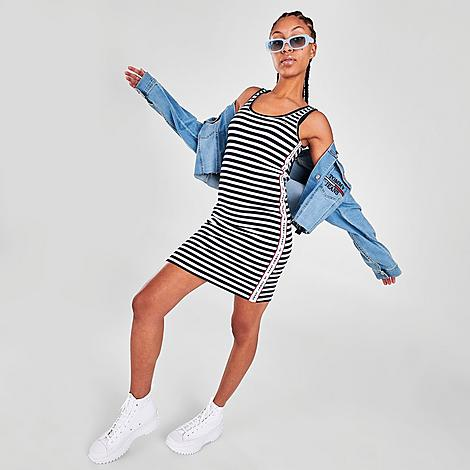 Tommy Jeans Women's Ribbed Tank Dress in Blue/White/Sky Captain Size Large Size & FitSlim, body skimming fit Product FeaturesSoft and slightly stretchy blended fabric has a textured ribbed finish Logo branding at front Tank silhouette Machine wash The Tommy Jeans Ribbed Tank Dress is imported. When it's too hot to plan a 'fit, grab the Women's Tommy Jeans Ribbed Tank Dress and you're good to go! This one-piece wonder features stretchy ribbed fabric and a flattering silhouette. Size: Large. Color: Blue/White. Gender: female. Age Group: adult. Tommy Jeans Women's Ribbed Tank Dress in Blue/White/Sky Captain Size Large