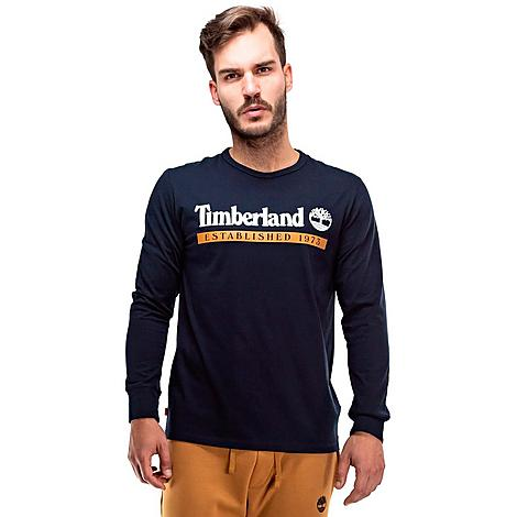 Timberland Men's Established 1973 Long-Sleeve T-Shirt in Blue/Dark Sapphire Size Medium Cotton Size & Fit Standard fit is athletic and relaxed Long sleeves for enhanced coverage Made from Sustainable Materials Feel good about what you're wearing thanks to the organic cotton used to make this item 100% organic cotton Product Features Cotton material is lightweight and comfortable Ribbed neckband and cuffs Established 1973 logo at the chest Machine wash The Timberland Established 1973 Long-Sleeve T-Shirt is imported. Lightweight coverage teams up with a long-sleeve silhouette on the Men's Timberland Established 1973 Long-Sleeve T-Shirt. Pair it up with your favorite jeans for the perfect street-ready look. Size: Medium. Color: Blue. Gender: male. Age Group: adult. Timberland Men's Established 1973 Long-Sleeve T-Shirt in Blue/Dark Sapphire Size Medium Cotton